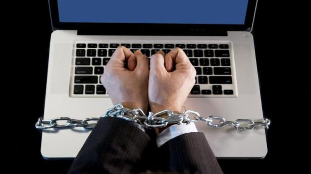 Chained Hands on laptop