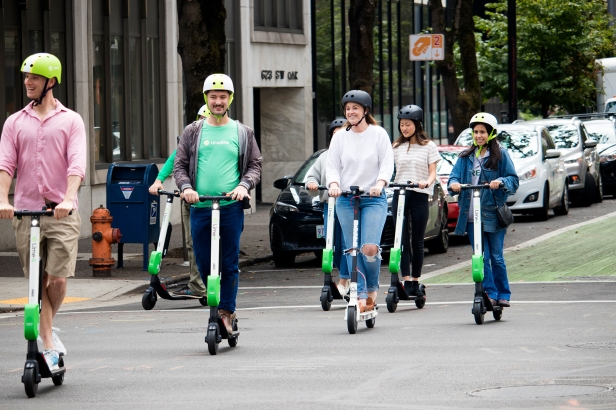 e-scooter-riders-on-street-1600